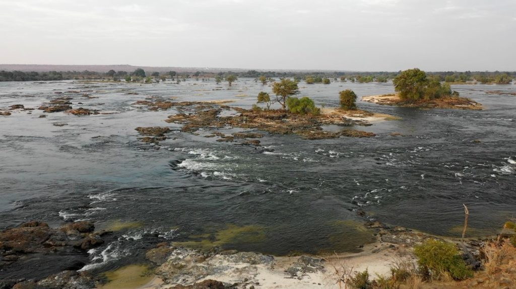 The Zambezi River Flowing Towards The Mighty Victoria Falls